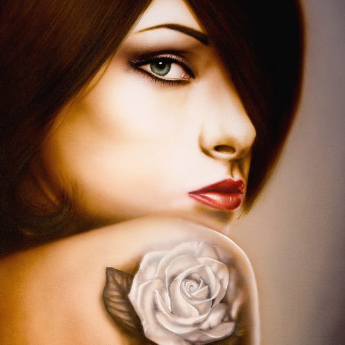 girl with rose tattoo on shoulder